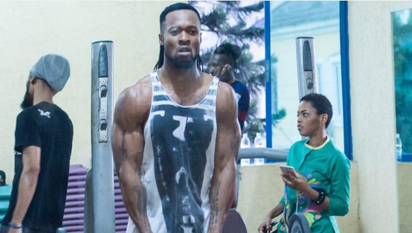 Flavour in the gym and his muscles (Photos)