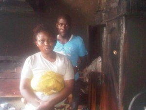 Shakiru with wife, Boash inside the burnt out apartment