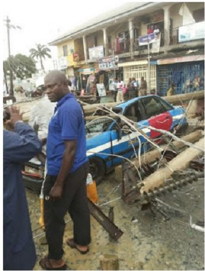 Car crushed by electric pole1