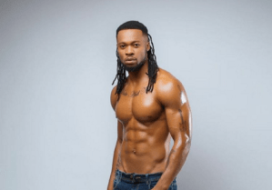 Flavour N'abania shares his strong man photo