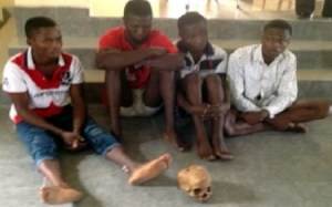 Young men caught with human skull