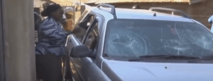 Watch: Angry Kenyan woman destroy husband's car over alleged cheating (Photos + Video)