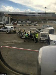 Woman jumps out of taxiing plane