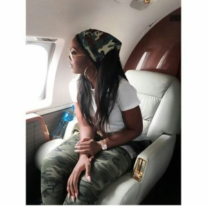 Tiwa Savage stuns in Camo outfit,as she jets out with Crew members