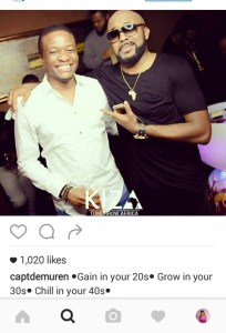 Captain Demuren and Banky w pose for the camera