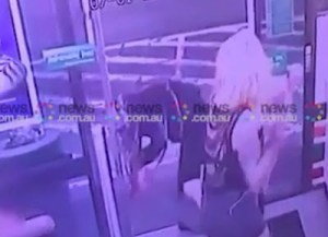 Shocking! Woman with axe violently attacks customers in Australia (Graphic video)