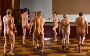 See the bizarre exercise where participants work out naked