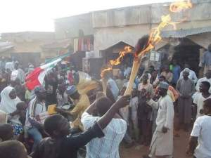 Individuals in Kaduna burn their brooms as they decamp from APC to PDP