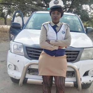 Pretty police officer wearing tight skirt sparks social media buzz (Photo)