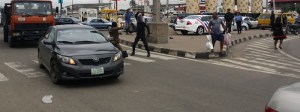 Between policemen and a mad man in Lagos traffic. (Photos/Video)