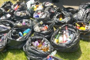Hundreds of bottles of alcohol seized as teens descend on a British beach for mass party
