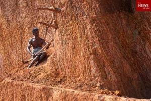 Omg! See the disabled man who spent 3 years single-handedly carving a road through a hill (Photos)