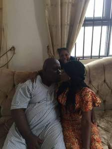 Photos of Asari Dokubo kissing his wife as he shows off his children
