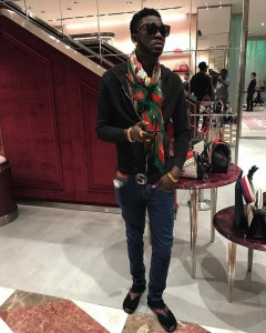 Investor BJ set to rival Hushpuppi, poses with bags of Gucci