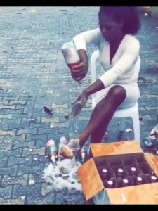 Slay Queen pops 100 bottles Of Andre Wine on her body after graduation 9Photo & Video)