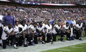 American football stars drop to their knees during national anthem to defy Trump