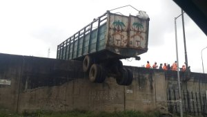 Haulage truck dangling dangerously over the bridge in Ojuelegba area of Lagos