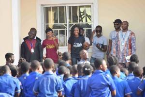 Debie Rise visits Rochas Foundation College, Jos, presents them with new Guitars