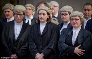 Britain ends courtroom tradition of wearing wigs and gowns in court