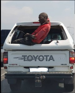 See This Drunk Man Urinating From A Moving Vehicle (Photos)