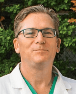 Top US surgeon found dead with knife in his chest by his 11-year-old daughter