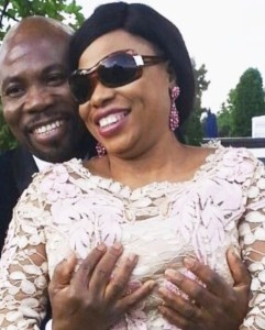 UK based pastor blasted for holding his wife's boobs in public (Photos)