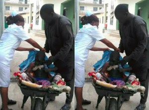 Man takes his son to hospital on Wheelbarrow because of fuel scarcity in Imo State- (Photos)