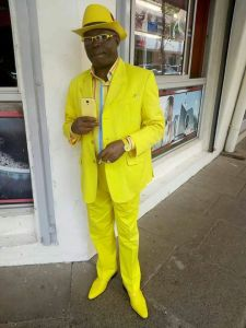 See the Kenyan Man who wears suits that matches his phone, watch & hat colour (Photo)