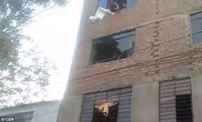Mum throws her baby out of a 4th floor window (Photos & Video)