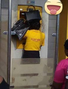 See How A Female Teacher In Enugu Is Using The ATM (Photo)