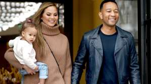 Chrissy Teigen Fires Back At Fan Over Her & John Legend Always Carrying Their Daughter (Photos)