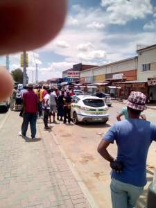 Police Rescue Nigerian Man Attacked & Almost Set Ablaze By Angry Mob In South Africa (Photos)