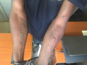 See this Oshodi phone thief that tattooed names of all the ladies he's had sex with on his body (Photo)