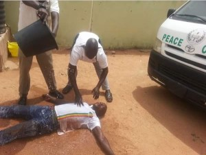 Peace Corps Member Faints After Buhari Rejected Peace Corps Bill (Photo & Video)