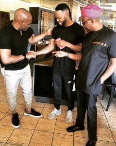 See How Billionaire, Tony Elumelu Is Checking Out Flavour's Tattoos (Photo)
