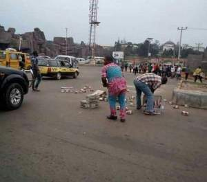 Bundles Of Money Litters Road As They Fall Out Of A Bullion Van In Owerri (Photo)