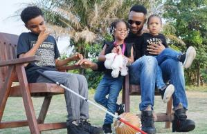See Beautiful Photo Of Flavour, His Daughters And The Liberian Blind Artist, Semah G. Weifur