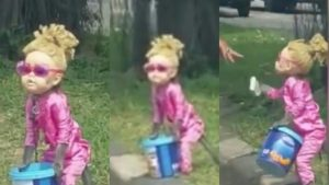 Watch As Monkey Dressed As A Blonde Little Girl & Forced To Beg On The Roadside (Video)