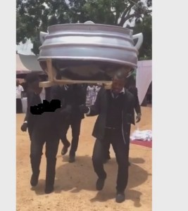 Food Seller Buried Inside A Giant Cooking Pot In Ghana (Photos)