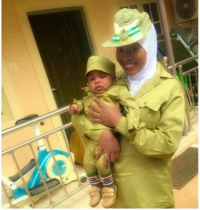 Female Corper And Her Child Rock NYSC Kaki In Adorable Photos