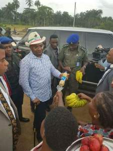 Governor Udom Stops His Convoy To Buy From Roadside Banana Sellers (Photos)