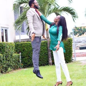 SUPER WOMAN!! Bride-to-be straggles and lifts her fiance in pre-wedding photo