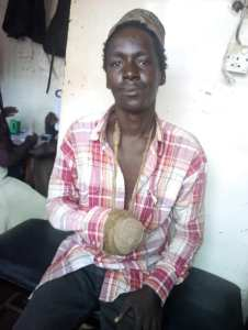 Fake Beggar With Fake Amputated Hand Caught And Exposed (Photos)