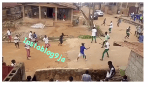 Check Out Secondary School Students Fighting With Cutlasses, Stones Over Girlfriend In Ibadan (Video)