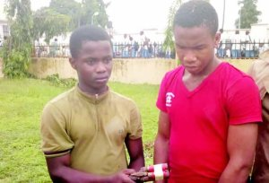Two Secondary School Students Caught With A Gun In Imo State (Photo)