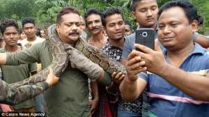 Big Python Almost Strangles Man To Death While Taking Selfie With It (Photos)