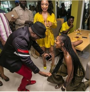 Tiwa Savage Kneels Down To Greet Sir Shina Peters (Photos)