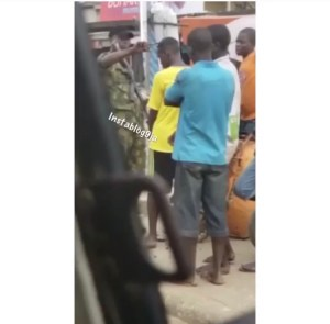 Soldier Barbing A Civilian's Hair Against His Wish In Egbeda, Lagos