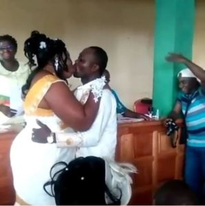Checkout This Couple's Wedding Kiss That Has Got People Talking (Photos+Video)