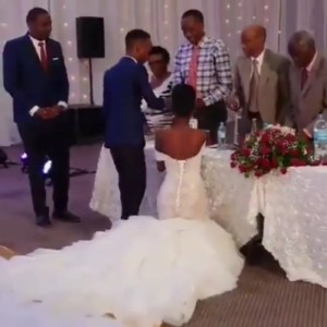 Bride Blasted For Kneeling Down To Greet Guests At Her White Wedding (Photos)
